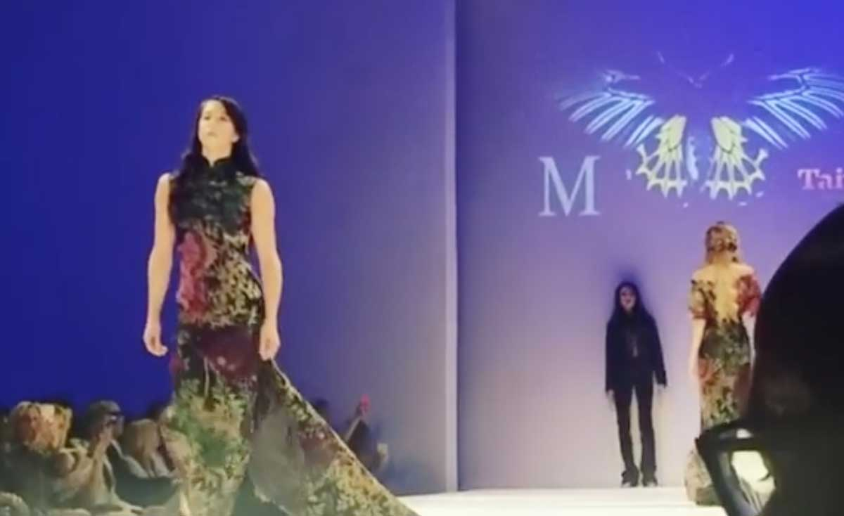 photo: Georgina Pazcoguin walking in Fashion Week runway shows