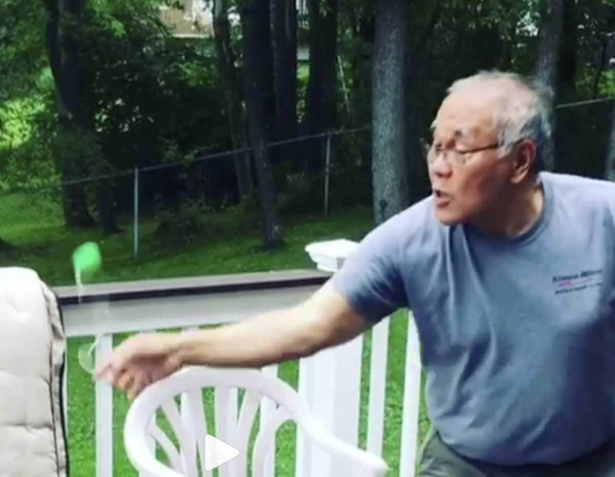 photo: Georgina Pazcoguin's father does a shooting star move with a yo-yo - tricky!